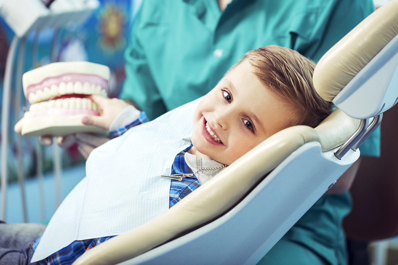 Little boy receiving dental care